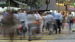 Crosswalk with busy people in Hong Kong Times Square.